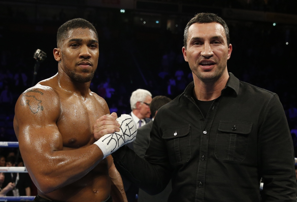 Boxing Britain - Anthony Joshua v Eric Molina IBF World Heavyweight Title - Manchester Arena - 10/12/16 Anthony Joshua celebrates his win with Wladimir Klitschko Action Images via Reuters / Andrew Couldridge Livepic EDITORIAL USE ONLY. - RTX2UGLQ