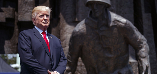 President Donald Trump listens as he is introduced to deliver a speech at Krasinski Square at the Royal Castle, Thursday, July 6, 2017, in Warsaw. (AP Photo/Evan Vucci)